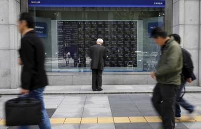 Asian shares slip off 1-1/2-year high