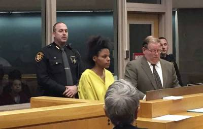 Woman admits to beheading her infant daughter but claims she 'loved her'