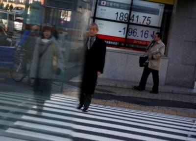 Asian markets edge up but caution prevails