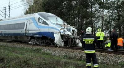 18 injured as train ploughs into lorry in Poland