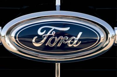 Ford to cut 1,400 jobs in Asia, North America
