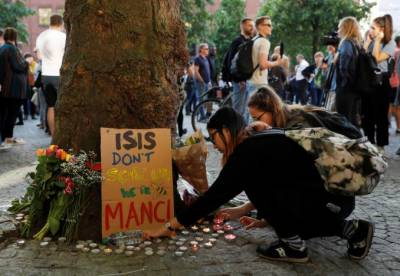 Manchester police name suicide bomber, threat level raised to critical