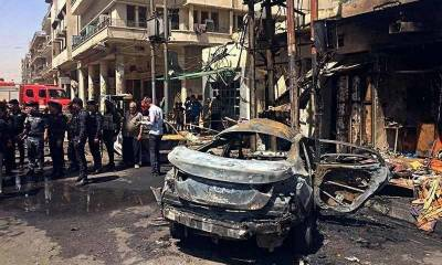 Two car bombs kill 14, injure 50 in central Baghdad