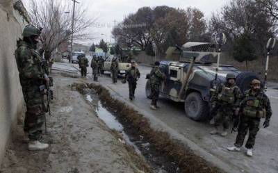 Attack on Afghanistan police headquarters leaves dozens dead, wounded