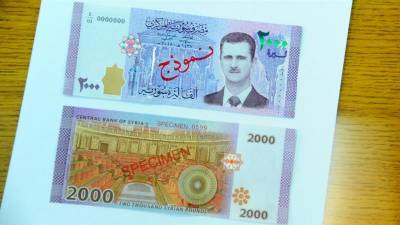 Bashar al-Assad featured on banknote for first time