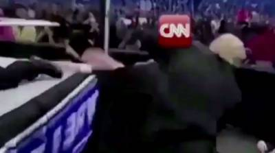 Watch: Trump sets off furor by beating figure depicting news media