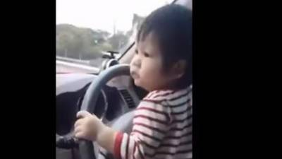 Watch: baby drive car on a busy highway, sparks outrage