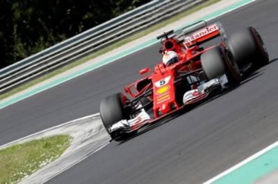 Motor racing: Vettel denies Hamilton a record-equalling pole