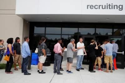 US jobless claims rise slightly