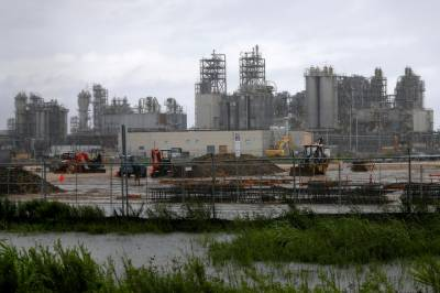 Crude dips, gasoline spikes as floods knock out almost a quarter of U.S. refineries