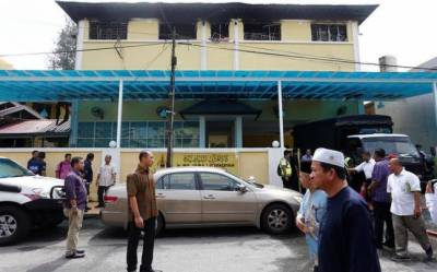 Boys 'cried from barred windows' as Islamic school blaze kills 23 in Malaysia