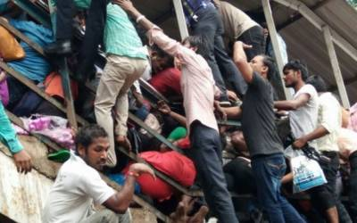 At least 22 dead, dozens injured in Mumbai railway bridge stampede