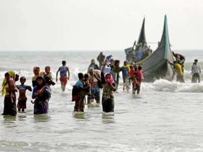 Dozen mostly children dead, scores missing as Rohingya boat capsizes