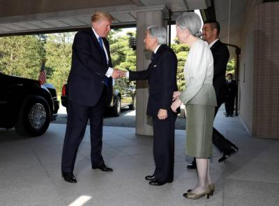 Trump greets Japanese emperor with a handshake and nod - but no bow
