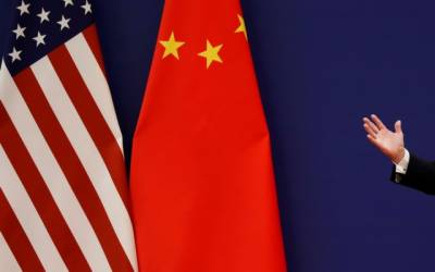 China urges cooperation after US brands it a competitor
