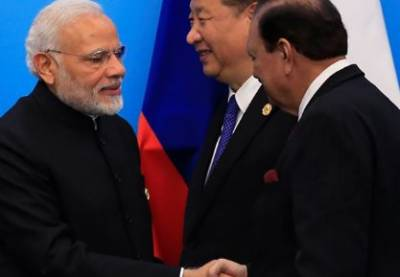 President Mamnoon Hussain, PM Modi shake hands at SCO meeting