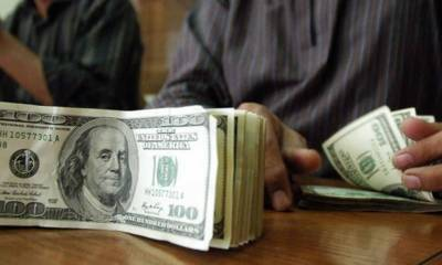 Rupee depreciates to Rs122 against dollar