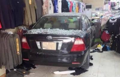 Woman rams car into dress shop
