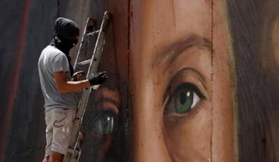 Israel arrests Italians who painted West Bank mural of Palestinian teen