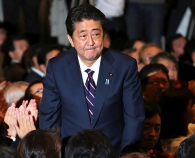 Japan's PM Abe re-elected as party head for three more years
