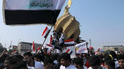 At least 14 killed, 865 injured after Iraqi security forces open fire on protesters